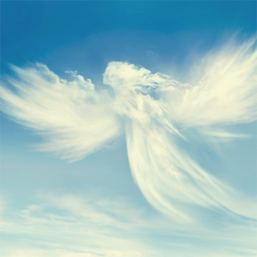 Bright light blue sky with clouds shaped like an angel with wings