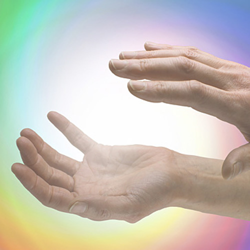 Hands holstering rainbow energy